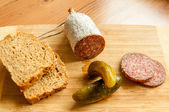 Salami slices with pickles — Stock Photo