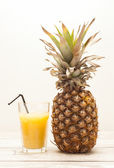 Pineapple on wooden board — Stock fotografie