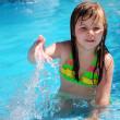 Girl in the swiming pool — Stock Photo