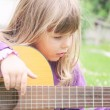 Girl with guitar — Stock Photo #17142693