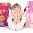 Happy little girl with gift — Stock Photo