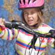 Stock Photo: Girl riding a bicycle