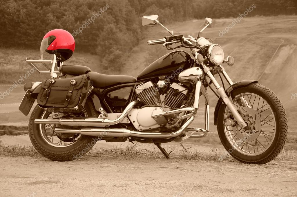 Powerful motorcycle with red helmet,sepia  Stock Photo #17167471