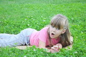 Girl in the grass — Stock Photo
