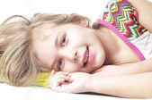 Sweet happy little girl in bed — Stock Photo