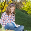 Girl with a book — Stock Photo #35279769