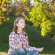 Cute little girl meditates — Stock Photo #35280925