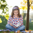 Stock Photo: Girl with a book