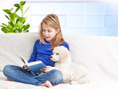 Girl and puppies — Stock Photo