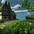 Old cottage in spring — Stock Photo