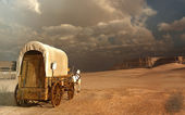 Old wagon in the desert — Stock Photo