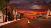 Sunset in a tropical town — Stock Photo
