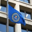 Stock Photo: FBI flag on FBI Headquarters,J.Edgar Hoover Building