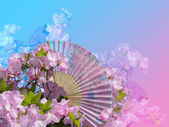Flowers and fan — Stock Photo