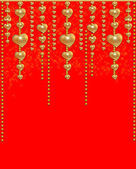 Gold beads and hearts — Stock Photo