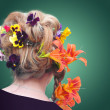 Woman with creative colorful a hairstyle with a flower — Stock Photo