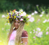 Girl in a beautiful flower wreath — Stock Photo