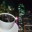 Cup of coffee with taste of night city — Stock Photo