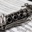 Clarinet over the page with notes — Stock Photo