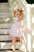 Baby girl and ladder — Stock Photo
