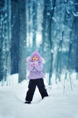 Portrait of girl in winter forest — Stock Photo