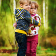 Kids standing together and embracing — Stock Photo