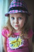 Cute girl wearing hat — Stock Photo