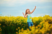 Small girl screaming on meadow — Stock Photo