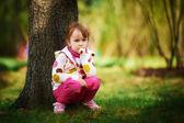 Little girl near tree in park — Stock Photo