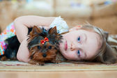Beautiful smiling girl with dog puppy — Stock Photo