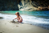 Little girl playing in sand — Stock Photo