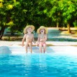 Little boy and girl in swimming pool — Stok fotoğraf