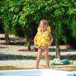 Little girl wearing lifebuoy in swimming pool — Stock Photo