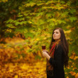 Young woman holding glass of red wine — Lizenzfreies Foto