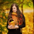 Young woman holding wicker basket — Stock Photo
