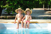 Small boy and girl in swimming pool — Stok fotoğraf