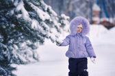 Girl touching fir-tree — Fotografia Stock