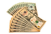 Background of dollar bills of various denominations. — Stock Photo