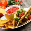 Plate with taco, nachos chips and tomato dip — Stock Photo
