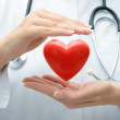 Doctor holding heart — Stock Photo