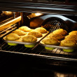 Baking muffins in oven — Stock Photo #22718823