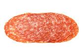 Slices of Smoked Sausage salami isolated on white — Stock Photo