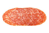 Slices of Smoked Sausage salami isolated on white — Stock Photo