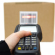 Woman hold scanner and scans barcode with laser — Stock Photo #39936133