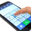 Stock Photo: Dialing on touchscreen smartphone