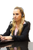 Businesswoman is helping customers in call center — Stock Photo