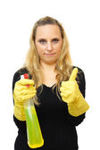 Smiling cleaner woman with thumbs up gesture Isolated over white — Stock Photo