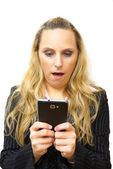 Surprised beautiful businesswomanl with smartphone — Zdjęcie stockowe