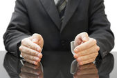 Businessman's protecting hands — Stock Photo