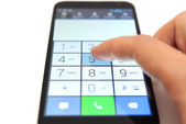 Dialing on touchscreen smartphone — Stock Photo